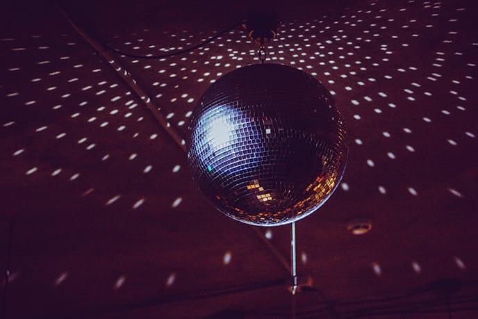 Event-DJ-Plays-Under-Prom-dance-disco-ball